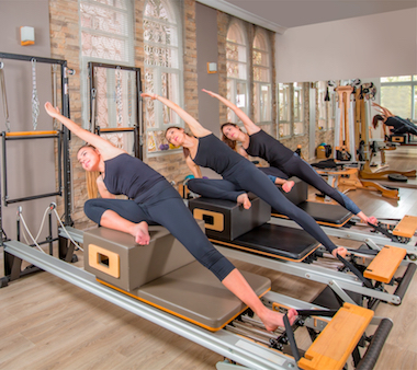 pilates class with 3 athletes